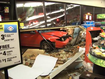 Vehicle Strikes Building in Red Hill
